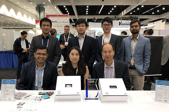 "The team led by Chair Professor Hoi-Sing Kwok (front right) and Assistant Professor Abhishek Srivastava (front left) from the Department of Electronic and Computer Engineering won the ""Best Prototype in Innovation Zone"" award from The Society for Information Display with the new display technology."