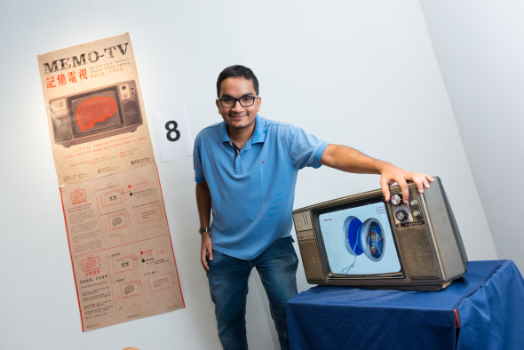 Urvil Sheth and the MemoTV he developed with his teammates in the Design Thinking course.
