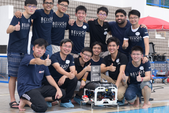 HKUST's Robotics Team leader Prof Woo Kam Tim (second left, front row), his team members and their ROV Beluga.