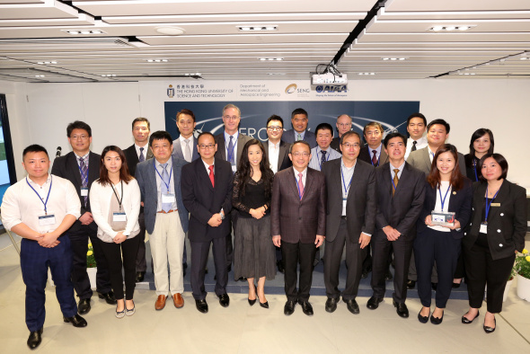 Representatives of participating companies and professional institutions in the aviation industry pose for a photo after souvenir presentation by Swire Professor of Aerospace Engineering Prof Xin Zhang (3rd from left, front row), Chair Professor of Mechanical and Aerospace Engineering, also with Ms Candy Nip (6th from right, front row), Principal Assistant Secretary for Transport and Housing (Transport), Prof Tim Kwang Ting Cheng (5th from right, front row), Dean of Engineering, and Prof Christopher Chao (1