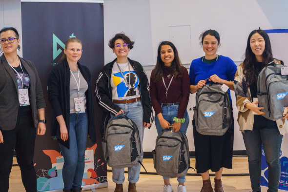 Mashiat Lamisa (third right) and her teammates Ilana Zimmerman (second right) and Dama Correch (third left) received the Empower Women Through Technology Prize at the cmd-f all-female* hackathon held at the University of British Columbia.