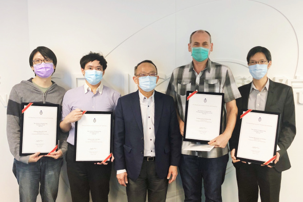 Excellence in teaching demonstrated by Prof. David Rossiter (second right), Prof. Ben Chan (second left), Prof. Henry Lam (first left) and Prof. Raymond Wong (first right). They were presented with the School's teaching awards by Dean of Engineering Prof. Tim Cheng (center).