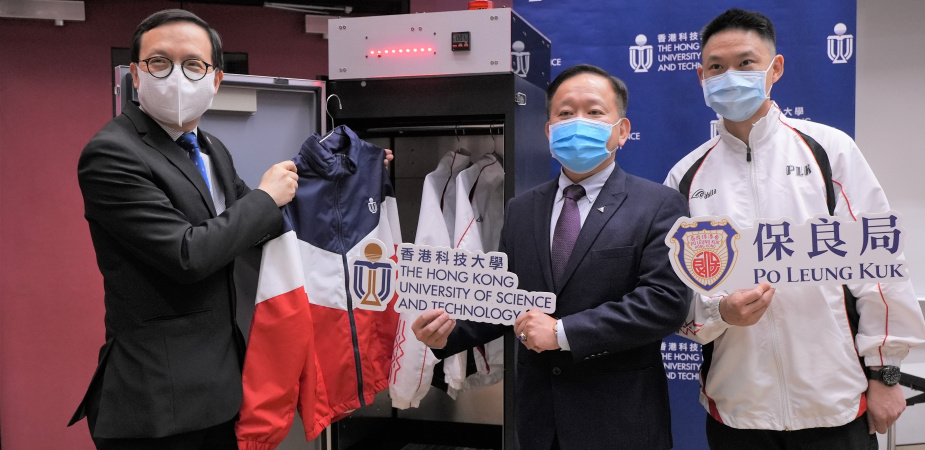 Prof. Ricky LEE Shi-Wei (middle), Chair Professor of the Department of Mechanical and Aerospace Engineering at HKUST, demonstrates how the UVC LED disinfection closet works, along with Mr. LAM Kwok-Wai (left) and Mr. Martin MAK, Principal and Assistant Warden respectively of the Po Leung Kuk Yu Lee Mo Fan Memorial School.