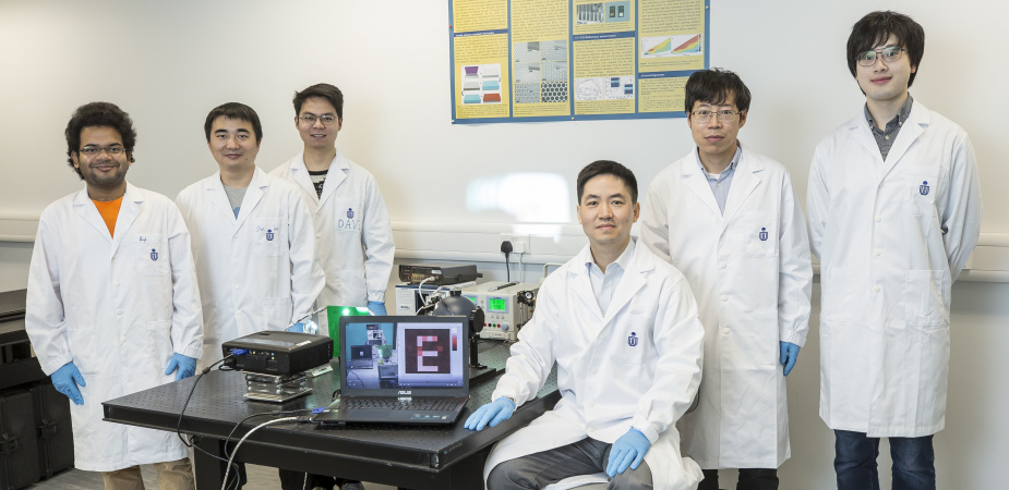 "The team has successfully made the prototype of the ""super human eye"" – an artificial visual system that uses a spherical biomimetic electrochemical eye with hemispherical retina made of a high-density perovskite nanowire array. From left: Swapnadeep Poddar, Shu Lei, Zhang Daquan, Prof. Fan Zhiyong, Dr. Gu Leilei and Long Zhenghao."