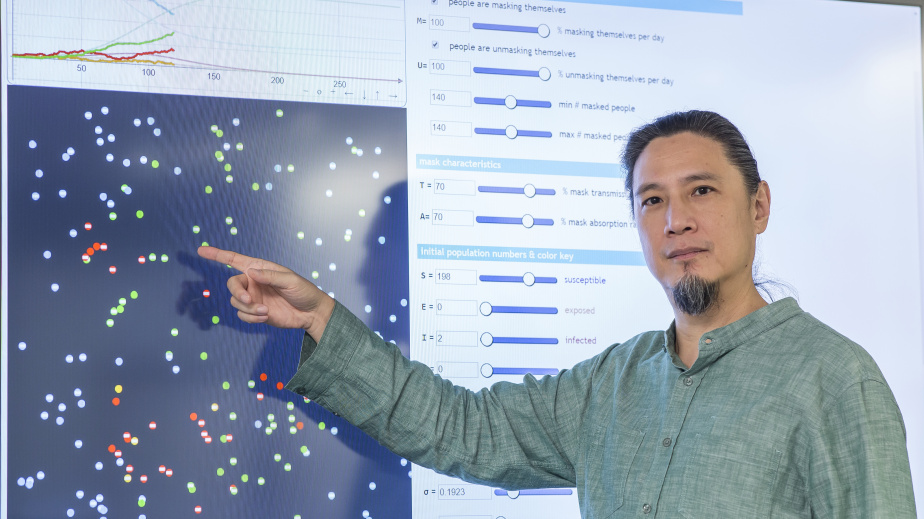De Kai, Professor of Computer Science and Engineering, demonstrates how the interactive visualization of the simulation works.