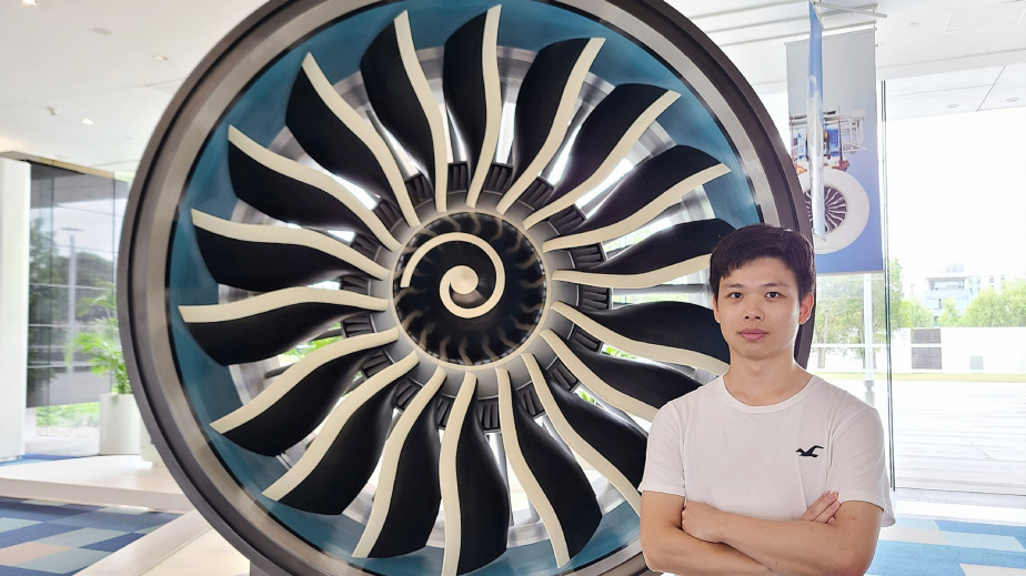 James with an airplane engine at GE Aviation, Shanghai.