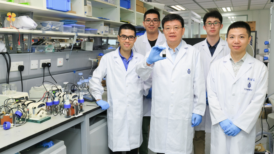 Prof. Zhao Tianshou (middle) and Prof. Chen Qing (first from left) and their research teams.