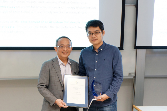 Prof. WANG Ji-guang, Assistant Professor of Chemical and Biological Engineering, was presented the Young Investigator Research Award by Prof. Tim CHENG Kwang-Ting, HKUST Dean of Engineering.