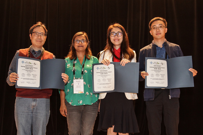 Prof. Cheung Shing-Chi (first left), PhD alumnus Dr. Liu Yepang (first right) and Wei Lili (second right) received the ACM SIGSOFT Distinguished Artifact Award at the 41st ACM/IEEE International Conference on Software Engineering (ICSE 2019).