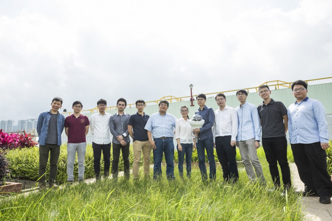 Prof. Wang (sixth left) and his research team are developing the fourth generation of the sensor that can harvest energy from solar panel and conduct data analytics by AI.