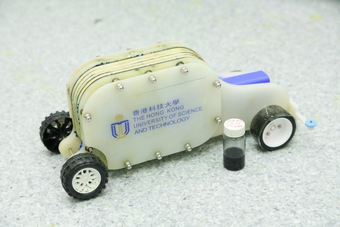 A demonstration vehicle with a bottle of the e-fuel.