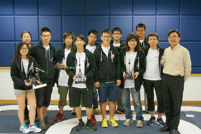 Stephen (third left), a member of the HKUST Robotics Team, built intelligent cars with his teammates on their own for a racing competition in Mainland China.