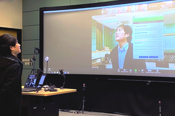 Prof. Ben Chan Yui-Bun, Director of the Center for Engineering Education Innovation, immersed in HKUST's specially designed mixed reality classroom, which offers many novel ways to teach and learn online and on-site and is a first for Hong Kong.