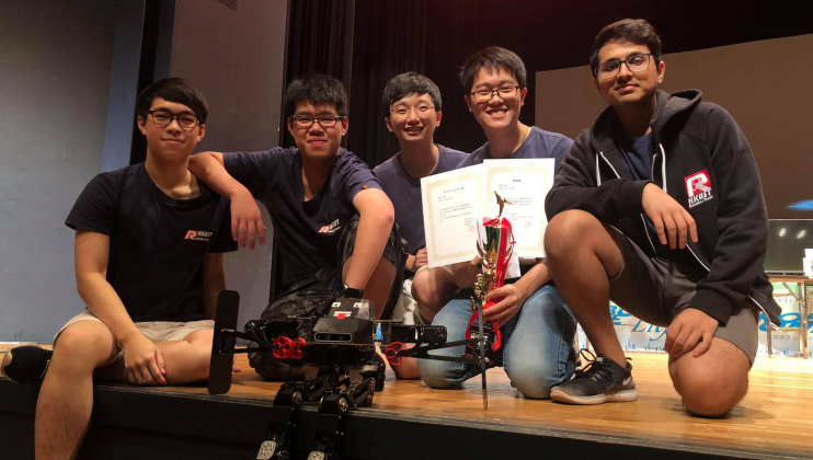 The winning team: (from left) Mak Ka-Hei, Leung Pok-Man, Mak Kin-Wing, Lee Chun-Hei and Amrutavarsh Sanganabasappa Kinagi, with their autonomous biped robot in front