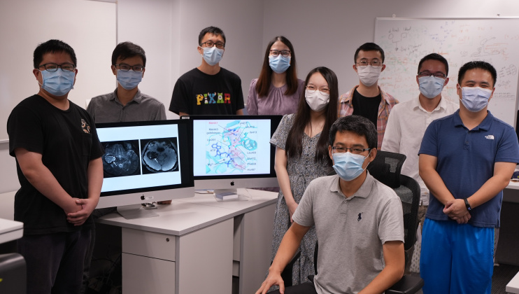 Prof. Wang Jiguang (front, seated) and his research team.